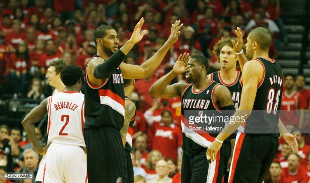LaMarcus Aldridge Wesley Matthews Robin Lopez and Nicolas Batum of the Portland Trail Blazers celebrate a play on the court in the first half of the...