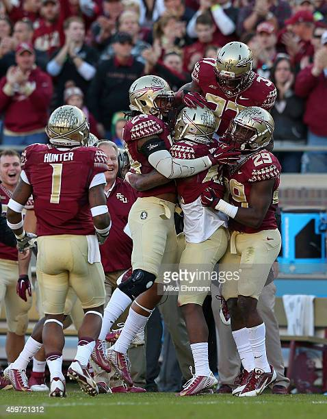 Lamarcus Brutus of the Florida State Seminoles celebrates an interception during a game against the Florida Gators at Doak Campbell Stadium on...