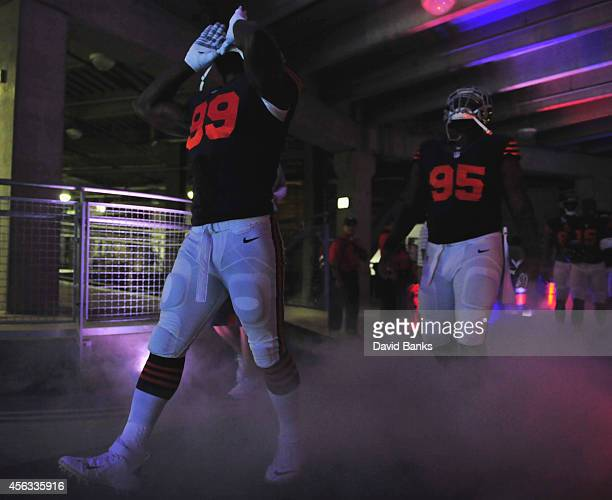 Lamarr Houston of the Chicago Bears and Ego Ferguson walk through the tunnel before the game against the Green Bay Packers on September 28 2014 at...