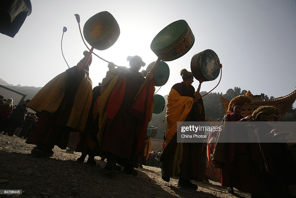 Lamas beat drums to scare away evil spirits during the 'Tiaoqian' praying ceremony at the Youning Temple on February 8, 2009 in Huzhu County of Qinghai Province, China. The Youning Temple holds the annual 'Tiaoqian' ceremony in the first lunar month each year. During the ceremony, monks will wear colourful traditional clothes and masks, performing the 'Fawang Dance' and 'Horse-headed Warrior Dance' to scare away evil spirits. Pilgrims also pray for good luck during the ceremony.