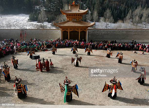 Lamas dance during the 'Tiaoqian' praying ceremony at the Youning Temple on February 8 2009 in Huzhu County of Qinghai Province China The Youning...
