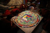 Lamas make a mandala sand painting which will be used for an enshrining ceremony at the Youning Temple on November 1 2009 in Huzhou County of Qinghai...