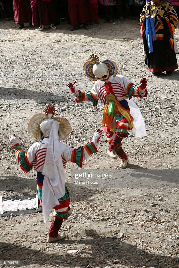 Lamas present skull dance during the 'Tiaoqian' praying ceremony at the Youning Temple on February 8, 2009 in Huzhu County of Qinghai Province, China. The Youning Temple holds the annual 'Tiaoqian' ceremony in the first lunar month each year. During the ceremony, monks will wear colourful traditional clothes and masks, performing the 'Fawang Dance' and 'Horse-headed Warrior Dance' to scare away evil spirits. Pilgrims also pray for good luck during the ceremony.