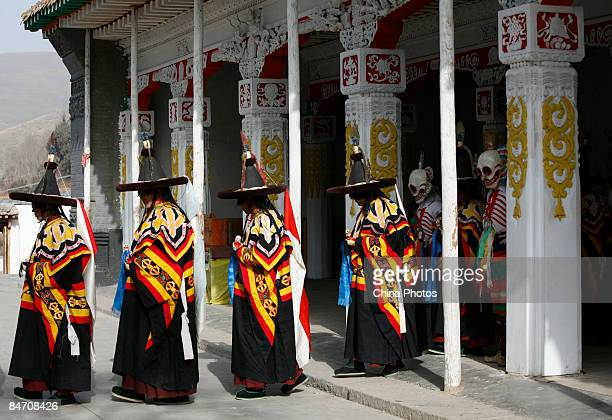 Lamas wait to dance during the 'Tiaoqian' praying ceremony at the Youning Temple on February 8 2009 in Huzhu County of Qinghai Province China The...