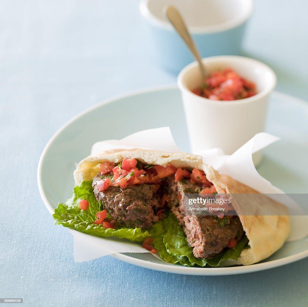 Lamb burger pita with two pepper chutney : Stock Photo