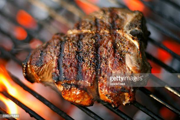 Lamb Chop Cooking on a Charcoal Grill