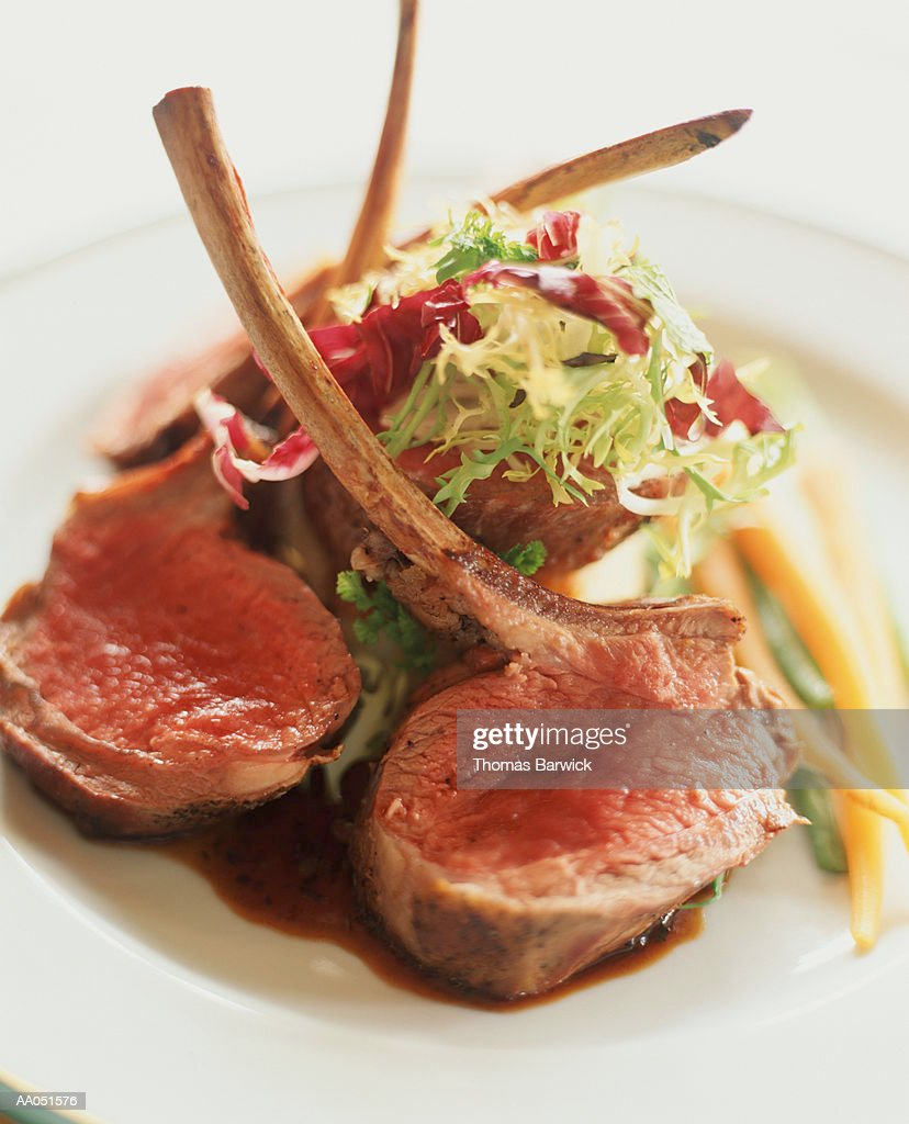 Lamb Chops on a Bed of Greens : Stock Photo