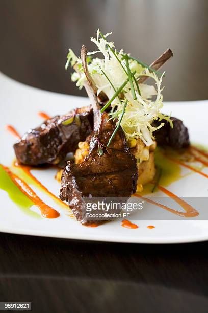 Lamb chops with frisee garnish and vegetable puree, close-up