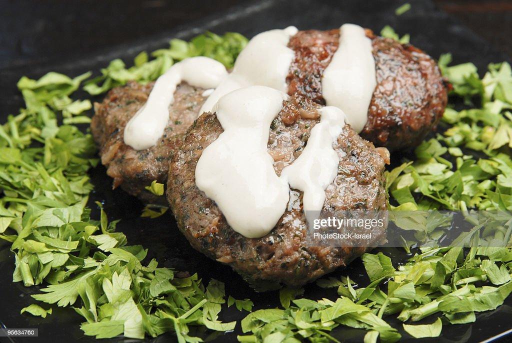 Lamb Kebab on lettuce  : Stock Photo