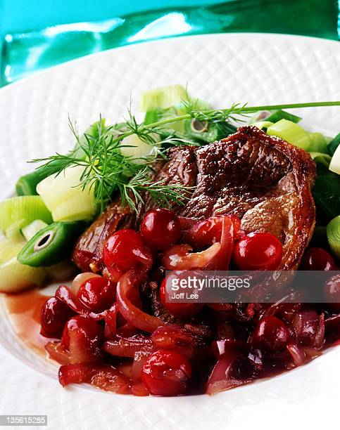 Lamb steaks with cranberry & redcurrant sauce