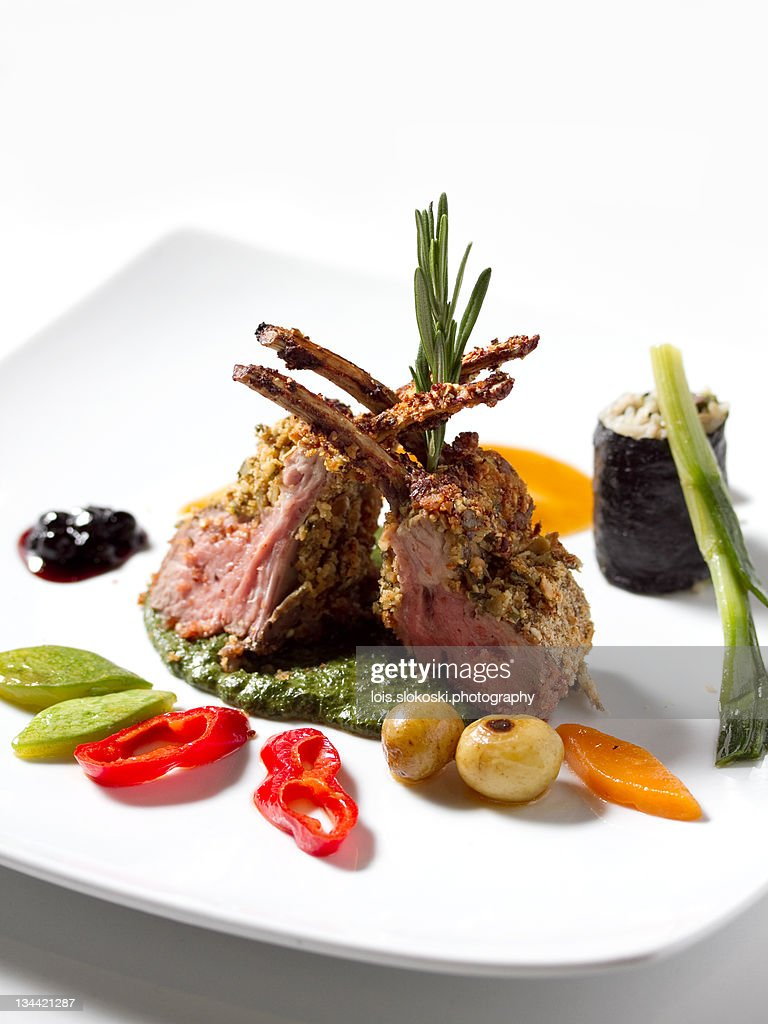 Lamb steaks with vegetables : Stock Photo