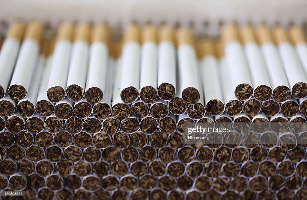 Lambert and Butler cigarettes, manufactured by Imperial Tobacco Group Plc, sit stacked ahead of packaging at the company's factory in Nottingham, U.K., on Friday, Feb. 1, 2013. Imperial Tobacco Group Plc is Europe's second-biggest tobacco company and generates about 40 percent of its profit from the region. Photographer: Chris Ratcliffe/Bloomberg via Getty Images