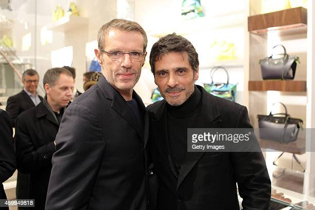 Lambert Wilson and Pascal Elbe attend the Longchamp Elysees 'Lights on Party' Boutique Launch on December 4 2014 in Paris France