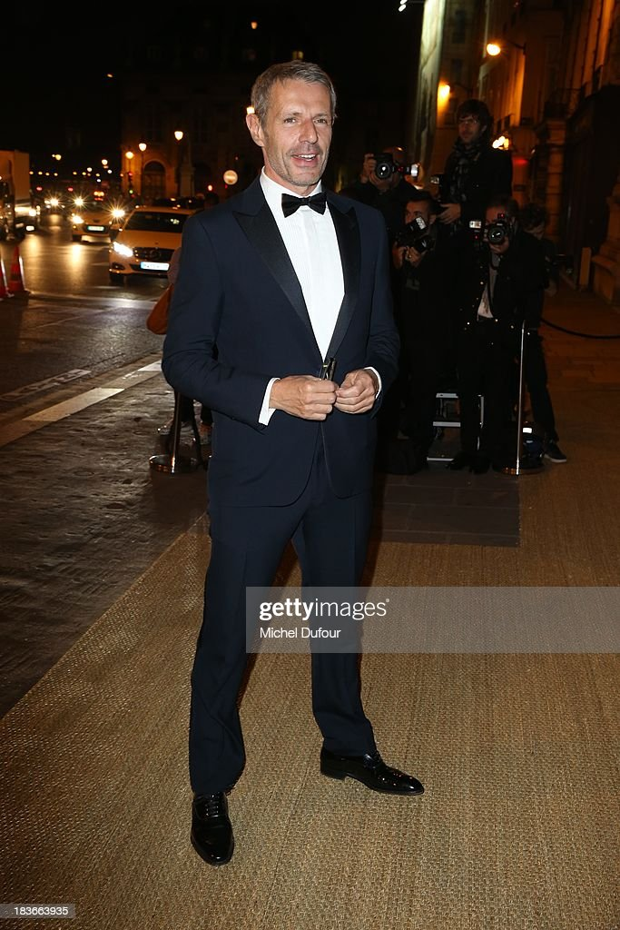 <a gi-track='captionPersonalityLinkClicked' href=/galleries/search?phrase=Lambert+Wilson&family=editorial&specificpeople=626933 ng-click='$event.stopPropagation()'>Lambert Wilson</a> arrives at a Ralph Lauren Collection Show and private dinner at Les Beaux-Arts de Paris on October 9, 2013 in Paris, France. On this occasion Ralph Lauren celebrates the restoration project and patron sponsorship of L'Ecole des Beaux-Arts.