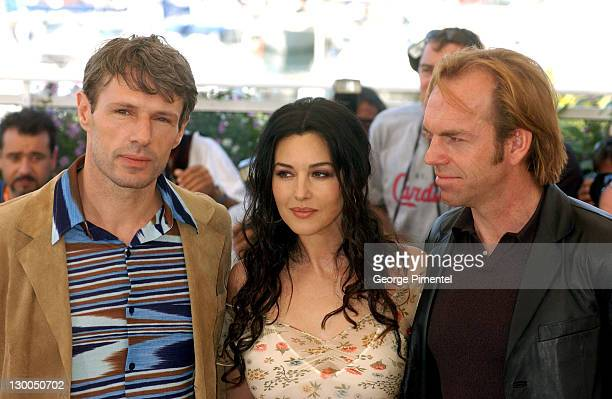 Lambert Wilson Monica Bellucci and Hugo Weaving during 2003 Cannes Film Festival 'Matrix Reloaded' Photo Call at Palais des Festivals in Cannes France