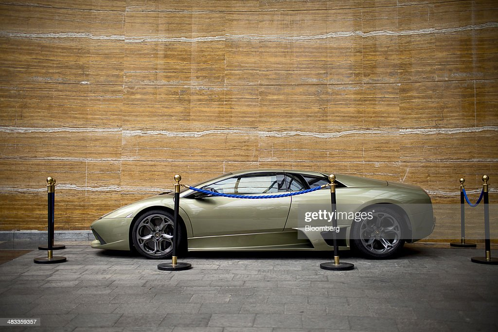 A Lamborghini Aventador sports car, produced by Automobili Lamborghini SpA, stands on display outside the Visun Royal Yacht Hotel in the Sanya Bay district of Sanya, Hainan Province, China, on Monday, April 7, 2014. The yuan is poised to recover from declines that have made it Asia's worst-performing currency as China seeks to prevent an exodus of capital that would threaten economic growth, according to the most accurate forecasters. Photographer: Brent Lewin/Bloomberg via Getty Images