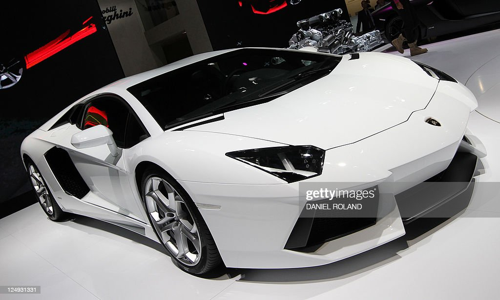 A Lamborghini Aventator is seen at the booth of Bugatti during the international motor show IAA in Frankfurt/M western Germany on September 14 2011...