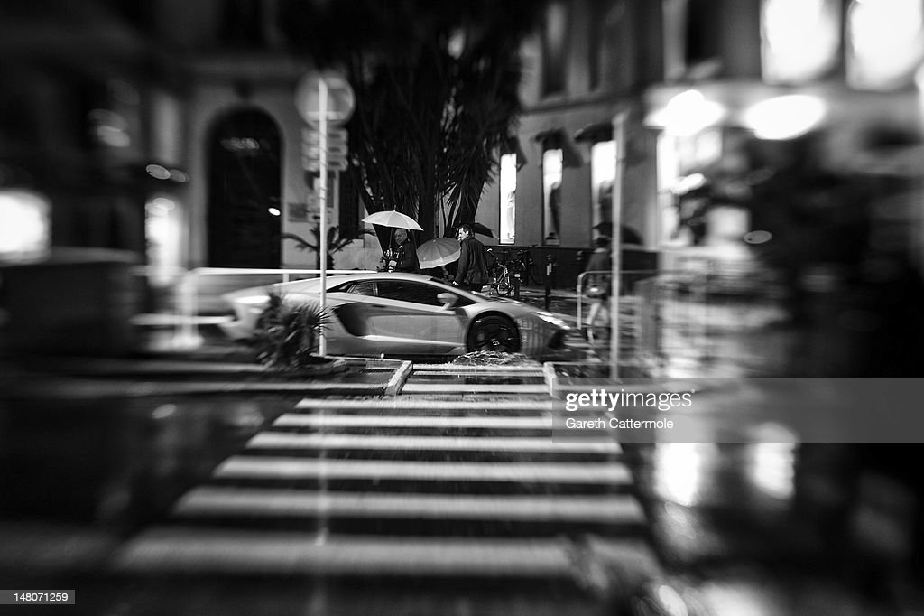 A Lamborghini is driven through rain during the 65th Annual Cannes Film Festival at Palais des Festivals on May 20, 2012 in Cannes, France.