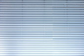 Grey blue metal / aluminium material background - horizontal lamellae