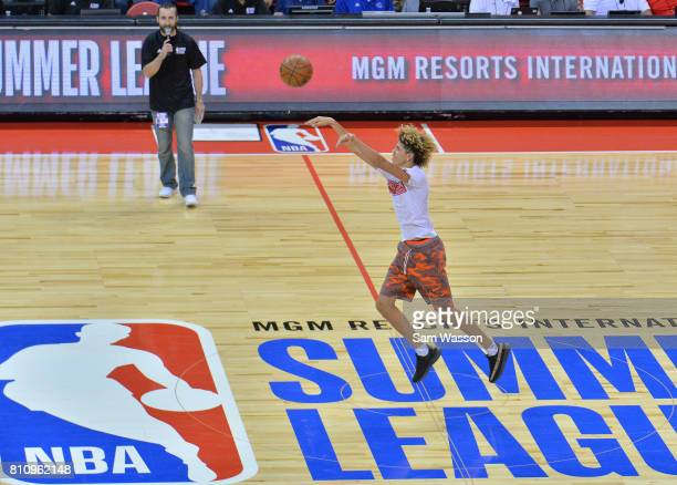 LaMelo Ball brother of Lonzo Ball of the Los Angeles Lakers shoots a halfcourt shot during a timeout in a game between the Los Angeles Lakers and the...