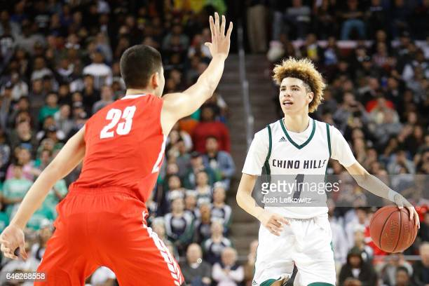 LaMelo Ball of Chino Hills High School brings the ball down court while being defended by Michael Wang of Mater Dei High School during the game...