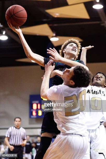 LaMelo Ball of Chino Hills High School is able to get above Jordan Schakel and Gianni Hunt of Bishop Montgomery High School as he shoots during the...