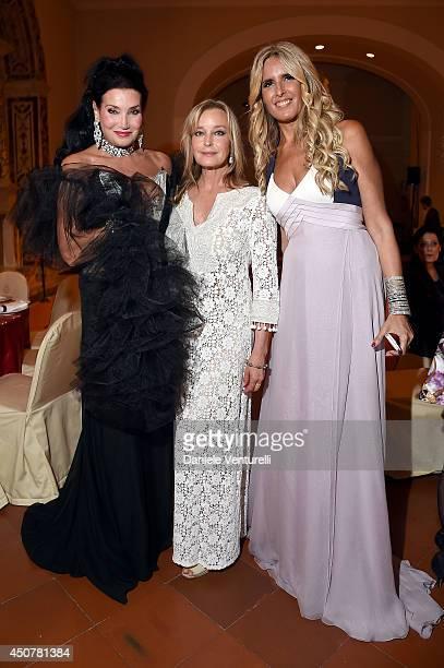 Lamia Khashoggi Bo Derek and Tiziana Rocca attend the Eva Longoria Foundation Dinner Gala during the 60th Taormina Film Fest at Hotel San Domenico on...