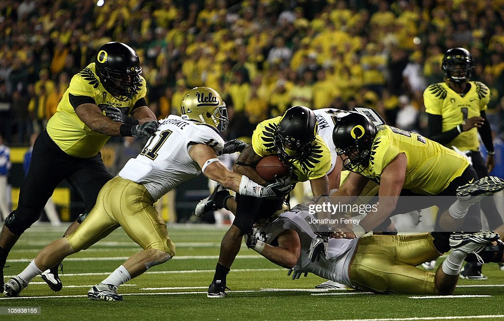 <a gi-track='captionPersonalityLinkClicked' href=/galleries/search?phrase=LaMichael+James&family=editorial&specificpeople=5532594 ng-click='$event.stopPropagation()'>LaMichael James</a> #21 of the Oregon Ducks runs the ball against Sean Westgate #11 of the UCLA Bruins on October 21, 2010 at the Autzen Stadium in Eugene, Oregon.