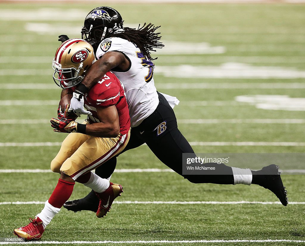 LaMichael James #23 of the San Francisco 49ers runs the ball against Dannell Ellerbe #59 of the Baltimore Ravens during Super Bowl XLVII at the Mercedes-Benz Superdome on February 3, 2013 in New Orleans, Louisiana.