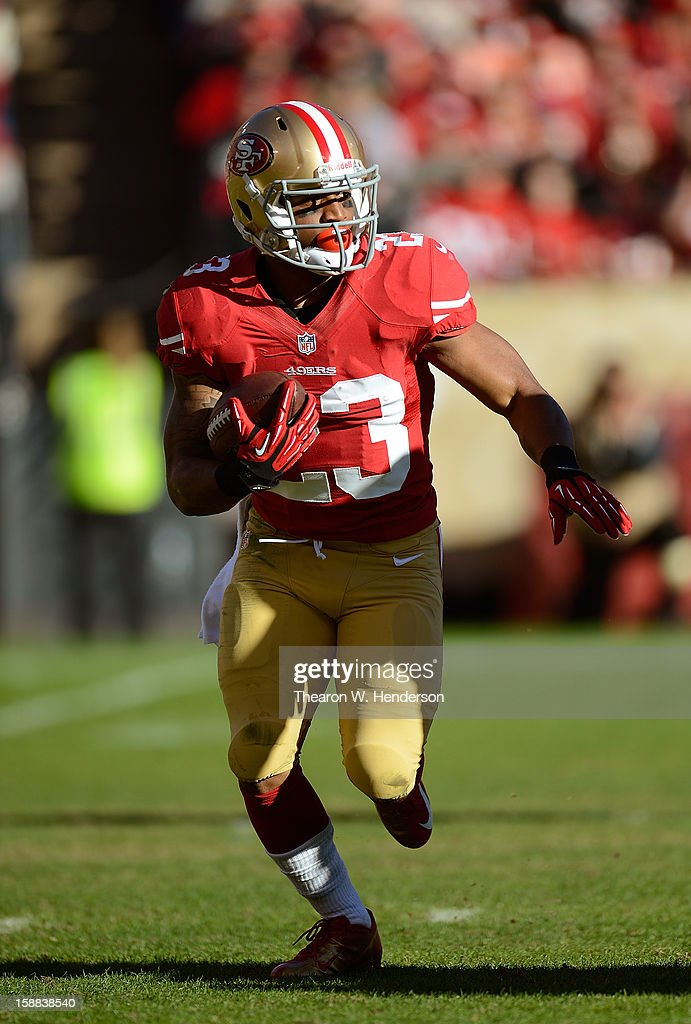 LaMichael James #23 of the San Francisco 49ers rushes with the ball against the Arizona Cardinals in the second quarter at Candlestick Park on December 30, 2012 in San Francisco, California. The 49ers won the game 27-13.
