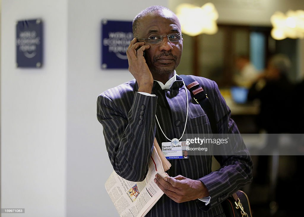 Lamido Sanusi, governor of the Central Bank of Nigeria, talks on his mobile phone in between sessions on day two of the World Economic Forum (WEF) in Davos, Switzerland, on Thursday, Jan. 24, 2013. World leaders, influential executives, bankers and policy makers attend the 43rd annual meeting of the World Economic Forum in Davos, the five day event runs from Jan. 23-27. Photographer: Jason Alden/Bloomberg via Getty Images