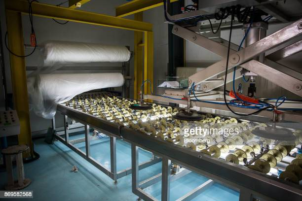 A lamination machine operates at the Somvang Glass Factory on the outskirts of Vientiane Laos on Wednesday Nov 1 2017 Asia'ssmallest economies...