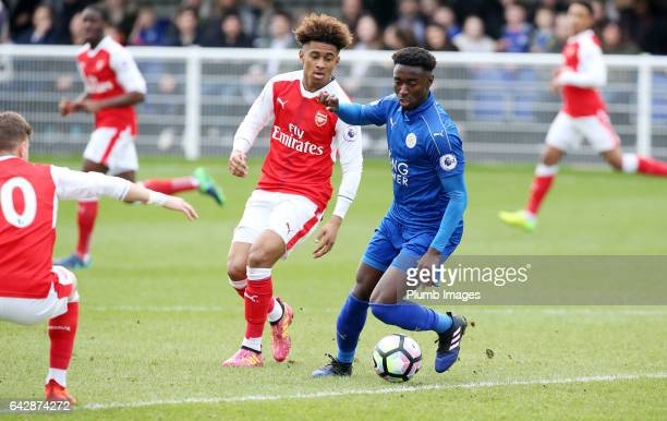 Lamine Kaba Sherif of Leicester holds off Reiss Nelson during the Leicester City v Arsenal U23 PL2 match at Holmes Park on February 19 2017 in...