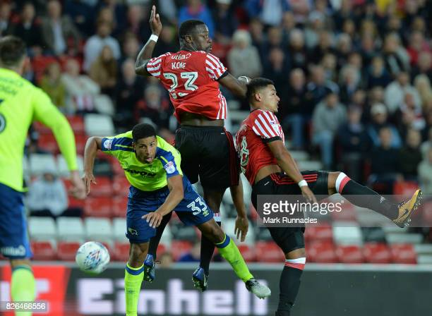 Lamine Kone and Tyias Browning of Sunderland challenge Curtis Davies of Derby County during the Sky Bet Championship match between Sunderland and...