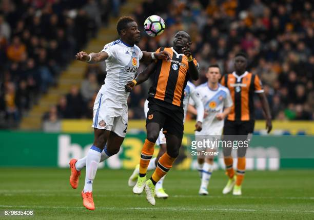 Lamine Kone of Sunderland and Oumar Niasse of Hull City battle for possession during the Premier League match between Hull City and Sunderland at the...