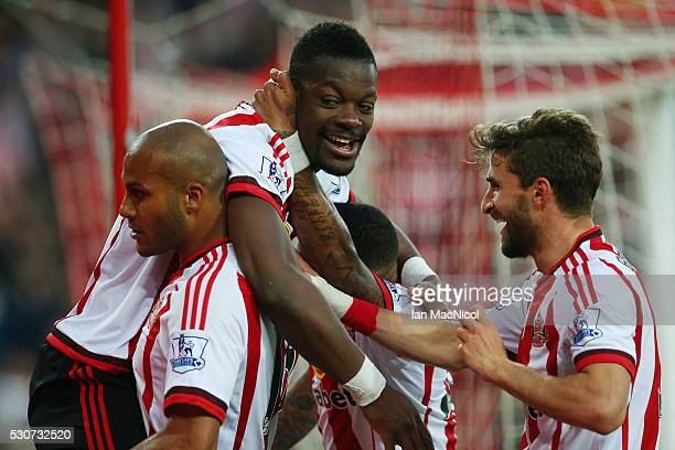 Lamine Kone of Sunderland celebrates scoring his team's third goal with team mates during the Barclays Premier League match between Sunderland and...