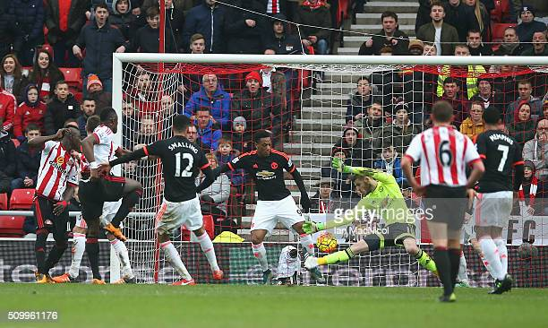 Lamine Kone of Sunderland heads the ball resulting in an own goal by David De Gea of Manchester United during the Barclays Premier League match...
