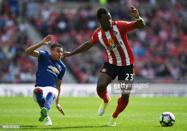 Lamine Kone of Sunderland is challenged by Jesse Lingard of Manchester United during the Premier League match between Sunderland and Manchester...