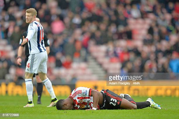 Lamine Kone of Sunderland reacts to a challenge from James McClean of West Bromwich Albion during the Barclays Premier League match between...