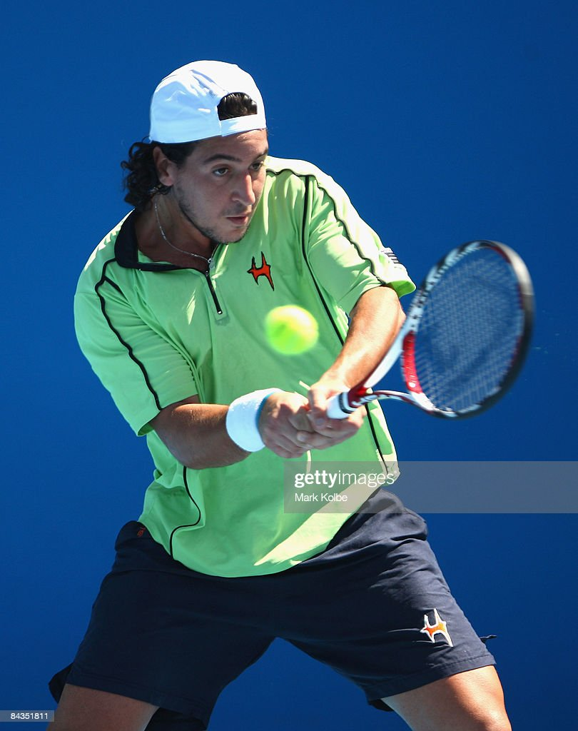 Lamine Ouahab of Algeria plays a backhand in his first round match against Florian Mayer of Germany during day one of the 2009 Australian Open at Melbourne Park on January 19, 2009 in Melbourne, Australia.
