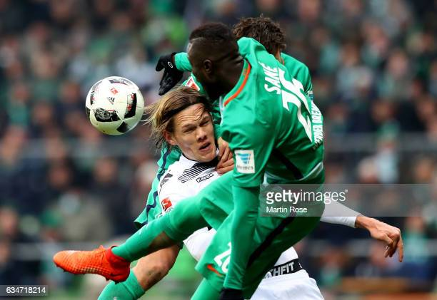 Lamine Sane of Bremen and Jannik Vestergaard of Moenchengladbach battle for the ball during the Bundesliga match between Werder Bremen and Borussia...