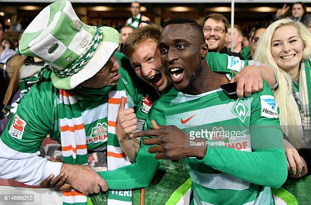 Lamine Sane of Bremen celebrate with the fans after the Bundesliga match between Werder Bremen and Bayer 04 Leverkusen at Weserstadion on October 15...