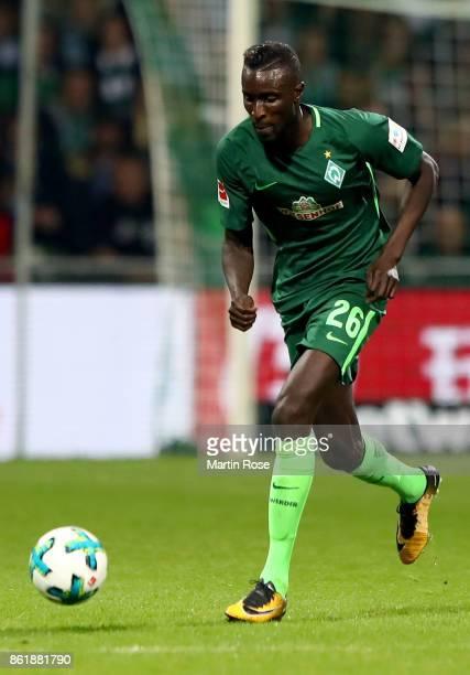 Lamine Sane of Bremen runs with the ball during the Bundesliga match between SV Werder Bremen and Borussia Moenchengladbach at Weserstadion on...