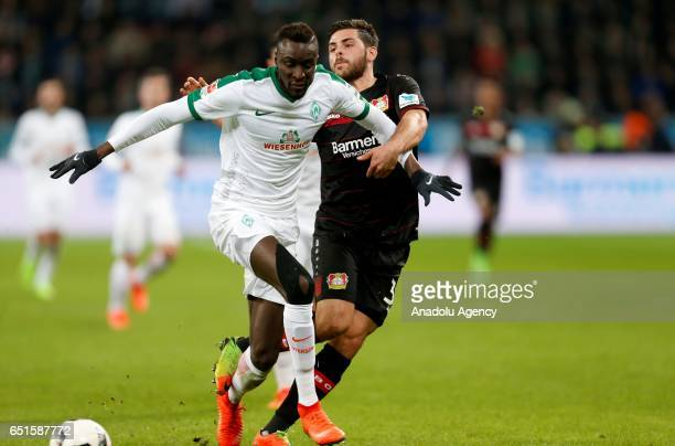 Lamine Sane of Werder Bremen and Kevin Volland of Bayer Leverkusen challenge with the ball during the Bundesliga soccer match between Bayer...