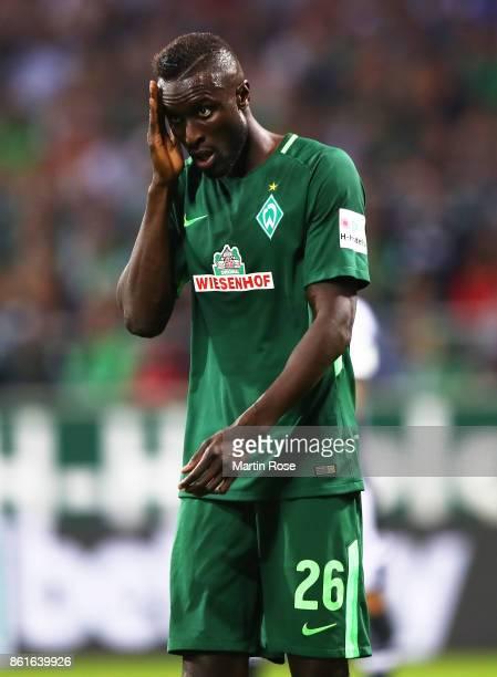 Lamine Sane of Werder Bremen is dejected during the Bundesliga match between SV Werder Bremen and Borussia Moenchengladbach at Weserstadion on...