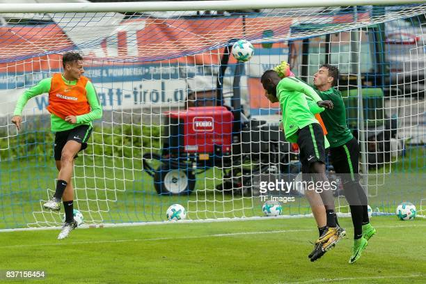 Lamine Sane of Werder Bremen Jesper Verlaat of Werder Bremen and Goalkeeper Jiri Pavlenka of Werder Bremen battle for the ball during the Training...