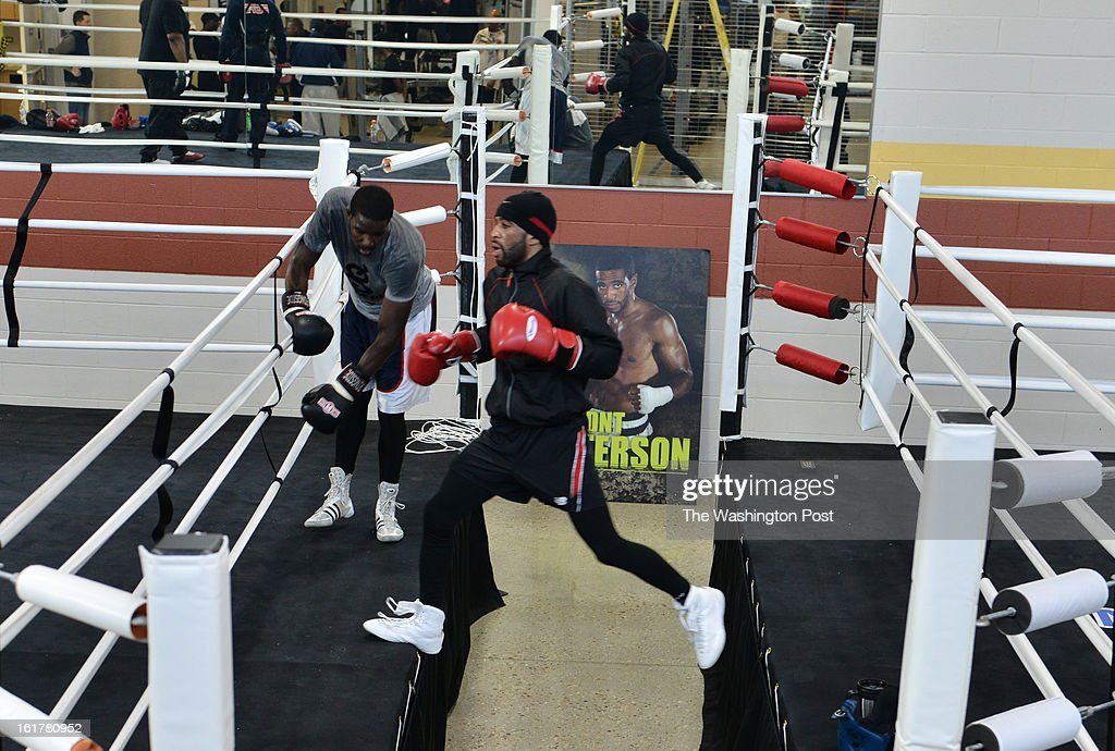 Lamont Peterson, foreground, jumps between boxing rings while training for his upcoming Feb 22nd fight while on February 6, 2013, in Washington, DC. Peterson is a DC native who, in 2011 at the Washington Convention Center, won the unified WBA and IBF light welterweight championship by beating heavily favored Amir Khan. Finally, after 14 months, Peterson (30-1-1) is less than 10 days from defending his belt against former World Boxing Organization junior welterweight champion Kendall Holt (28-5) on Feb. 22 at the D.C. Armory. Since his upset of Amir Khan by split decision to claim the IBF and World Boxing Association titles, Peterson's boxing career has been on hiatus largely because of a positive test for a banned substance. The IBF allowed Peterson to keep the title.
