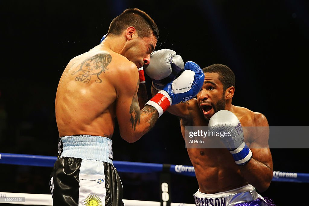 Lamont Peterson punches Lucas Matthysse during their Welterweight fight at Boardwalk Hall Arena on May 18, 2013 in Atlantic City, New Jersey.