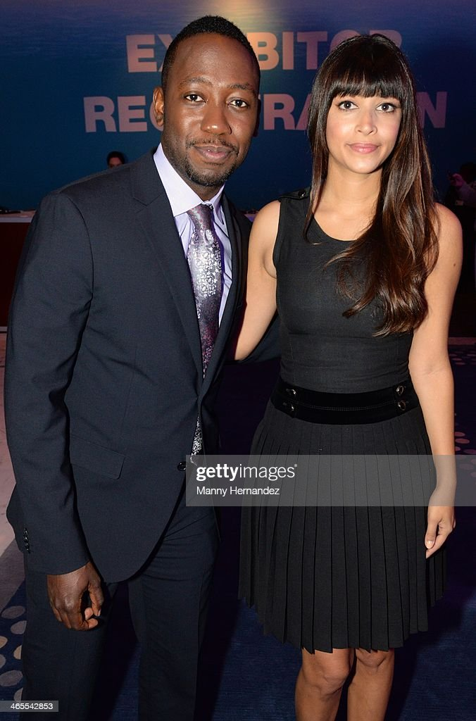 <a gi-track='captionPersonalityLinkClicked' href=/galleries/search?phrase=Lamorne+Morris&family=editorial&specificpeople=671004 ng-click='$event.stopPropagation()'>Lamorne Morris</a> and <a gi-track='captionPersonalityLinkClicked' href=/galleries/search?phrase=Hannah+Simone&family=editorial&specificpeople=3291351 ng-click='$event.stopPropagation()'>Hannah Simone</a> are sighted at NATPE 2014 in Miami Beach at Fontainebleau Miami Beach on January 27, 2014 in Miami Beach, Florida.