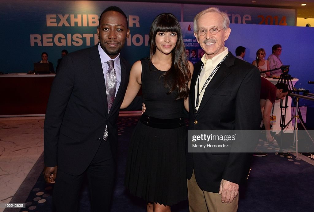 Lamorne Morris, Hannah Simone and and Dickie Smothers are sighted at NATPE 2014 in Miami Beach at Fontainebleau Miami Beach on January 27, 2014 in Miami Beach, Florida.